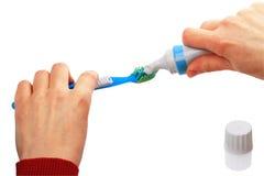 Toothbrush e dentífrico imagens de stock royalty free