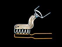 Toothbrush e dentífrico de néon Foto de Stock