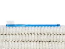 Toothbrush e toalhas. Fotografia de Stock