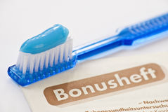 Toothbrush german bonusheft Royalty Free Stock Images