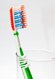 Toothbrush in a glass beaker Stock Photos