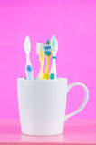 Toothbrush. In glass on pink background Stock Photography