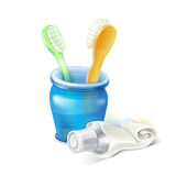 Toothbrush, glass and toothpaste Royalty Free Stock Images