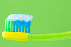 Toothbrush on green background Stock Image