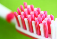 Toothbrush. On a green background Royalty Free Stock Image