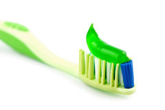 Toothbrush with green toothpaste isolated Royalty Free Stock Photo