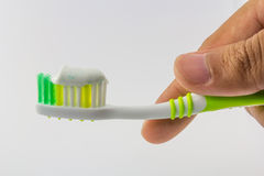 Toothbrush in hand Royalty Free Stock Photos