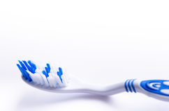 Toothbrush isolated on a white background with reflection and toothpaste. Blue plastic toothbrush. Concept of dental medicine. Stock Photos