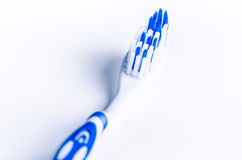 Toothbrush isolated on a white background with reflection and toothpaste. Blue plastic toothbrush. Concept of dental medicine. Stock Photography