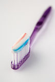 Toothbrush loaded with toothpaste Stock Images