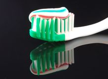 Toothbrush and paste. Toothbrush with multi colored paste Royalty Free Stock Images