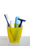 Toothbrush and Razor in Cup Stock Photo
