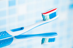 Toothbrush with red stripe toothpaste Royalty Free Stock Photography