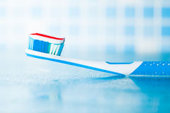 Toothbrush with red stripe toothpaste Royalty Free Stock Images