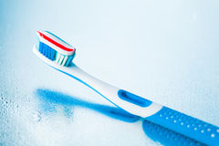 Toothbrush with red stripe toothpaste Royalty Free Stock Photos