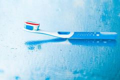 Toothbrush with red stripe toothpaste Stock Photos