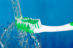 Toothbrush with splashing Royalty Free Stock Images