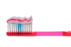 Toothbrush with striped toothpaste. Semi transparent plastic toothbrush with striped toothpaste royalty free stock photo