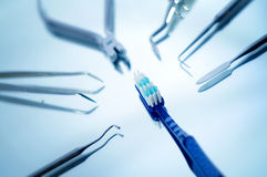 Toothbrush surrounded by dental instruments Royalty Free Stock Photography