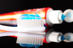 Toothbrush and toohpaste tube. On black Stock Photo