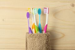 Toothbrush tooth-brush with bath towel on wooden table. top view with copy space. Toothbrush tooth-brush with bath towel on wooden background. top view with copy Stock Photography