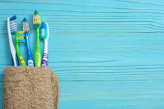 Toothbrush tooth-brush with bath towel on wooden table. top view with copy space. Toothbrush tooth-brush with bath towel on wooden background. top view with copy Royalty Free Stock Image