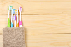 Toothbrush tooth-brush with bath towel on wooden table. top view with copy space. Toothbrush tooth-brush with bath towel on wooden background. top view with copy Stock Image