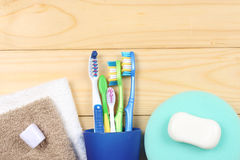 Toothbrush tooth-brush with bath towel on wooden table. top view with copy space. Toothbrush tooth-brush with bath towel on wooden background. top view with copy Royalty Free Stock Photography