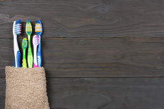 Free Toothbrush Tooth-brush With Bath Towel On Wooden Table. Top View With Copy Space Stock Images - 96977894