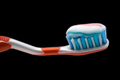Toothbrush with toothpaste. For teeth hygiene and care on black background Stock Image