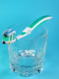 Toothbrush and toothpaste. On a glass Stock Photography