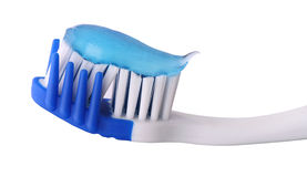 Toothbrush with toothpaste. On white background Stock Photography