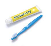 Toothbrush and Toothpaste. A tube of toothpaste and toothbrush isolated on a white background Royalty Free Stock Image