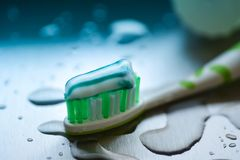 Toothbrush and toothpaste on blurred background. Close up Stock Images