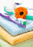 Toothbrush with toothpaste on fresh towels Royalty Free Stock Images