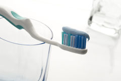 Toothbrush with toothpaste with glass Royalty Free Stock Image