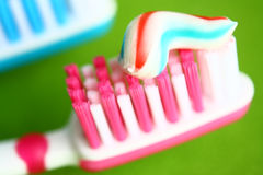 Toothbrush and toothpaste. On a green background Stock Image