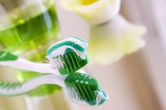 Toothbrush with toothpaste and rinsing liquid Stock Photos