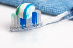 Toothbrush and toothpaste, towel, water spray. Royalty Free Stock Photo