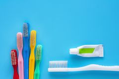 Toothbrush with toothpaste used for cleaning the teeth on blue background stock photos
