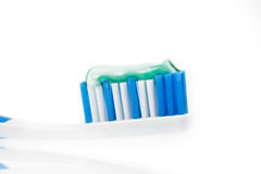 Toothbrush with toothpaste on white background Stock Photo