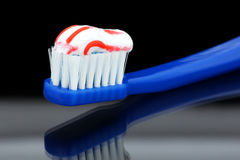 Toothbrush. Toothpaste on your toothbrush placed on a glass surface Royalty Free Stock Photo