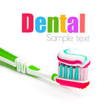 Toothbrush with tricolor toothpaste Royalty Free Stock Images