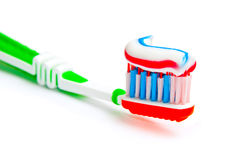 Toothbrush with tricolor toothpaste Royalty Free Stock Photo
