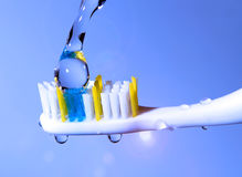Toothbrush under the running water Stock Photos