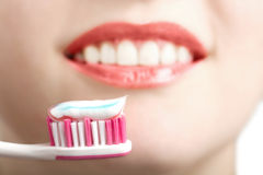 Toothbrush and white smile Royalty Free Stock Images