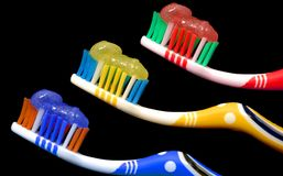 Toothbrushes. Colorful toothbrushes over black background Royalty Free Stock Photography