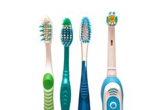 Toothbrushes. A row of toothbrushes (manual and electric Stock Photo