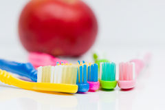 Toothbrushes and apple Royalty Free Stock Image