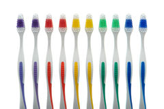 Toothbrushes of Assorted Colors in a Row Stock Images